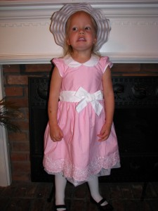 Tia in her Easter bonnet, which she didn't want to wear because she was a fraid it would mess up her hair.