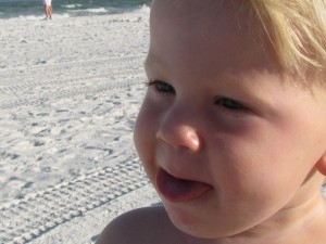 NOW - He's not too fond of the sand, particularly when it lands in his mouth.