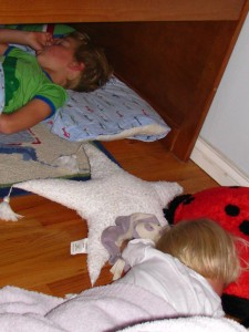 After finding the kids asleep like this several nights in a row (Tia is sounds asleep on the hard wood in this shot!), Lee and I finally told them they could camp out under the bed on Friday nights only. I think this is going to become  a fun little tradition for them.