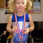 The birthday girl with her gymnastics medal