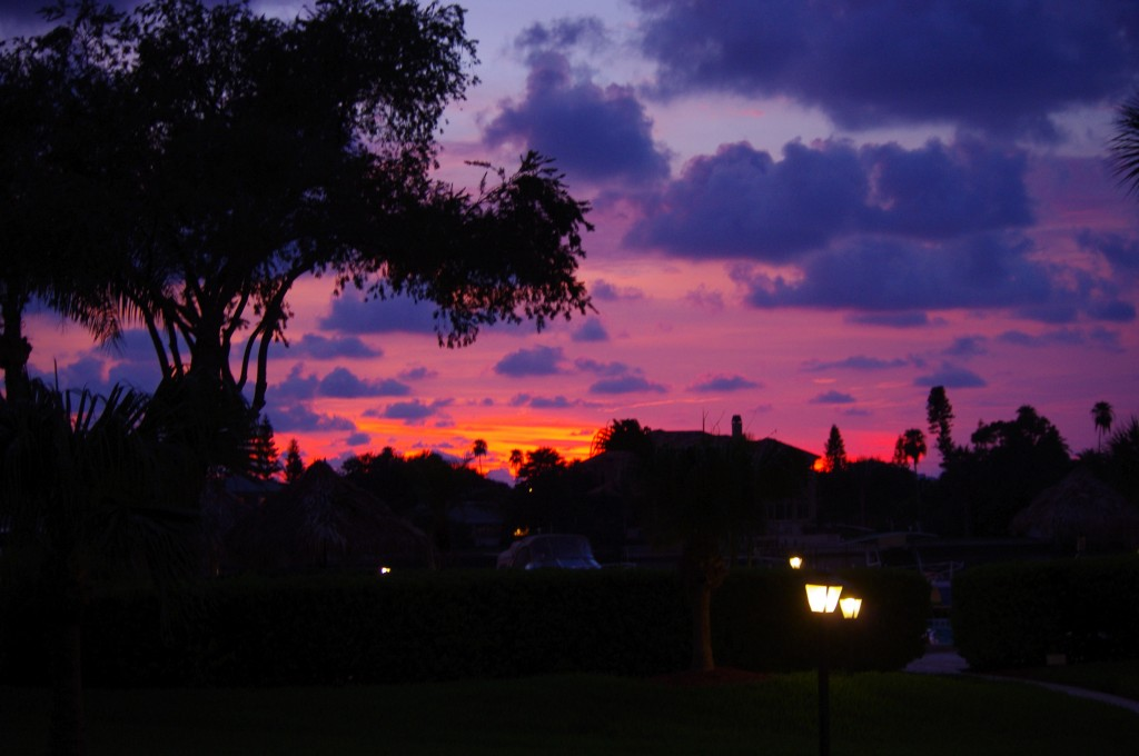 This is tonight's sunset from the back porch of my parent's condo. Um, yeah...I never get tired of this.