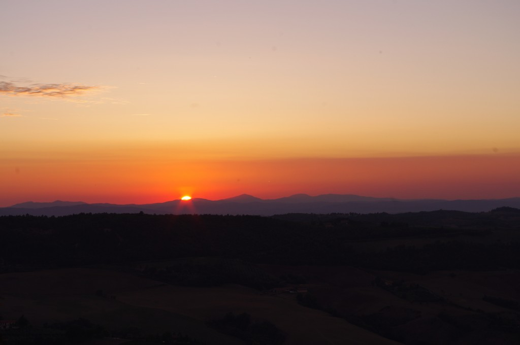 The sun setting over the hills from Montepulciano.
