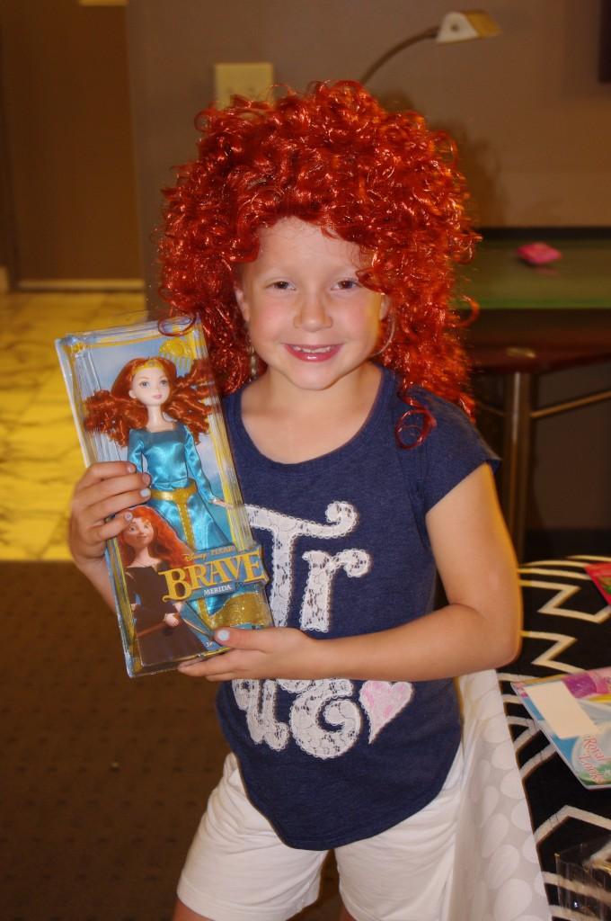 One of the joys of the conference was seeing Tia's face light up when we'd return to our room at night and find surprises left by the Disney elves. The night before Merida's coronation we received a huge bag full of Merida goodies including this doll and wig. The hair kills me. It's as though Little Orphan Annie and Cher had a love child...