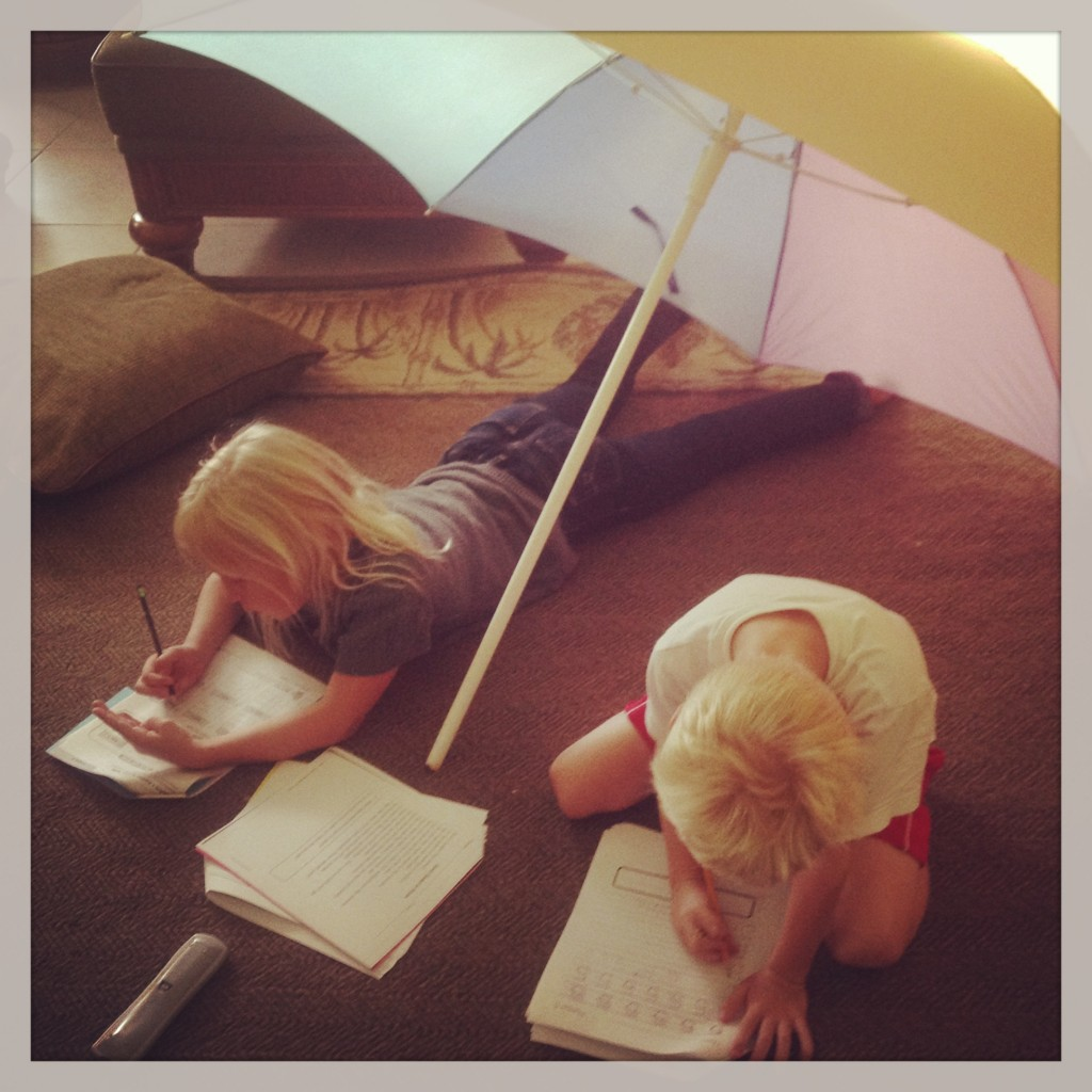 Summer school work under the umbrella.
