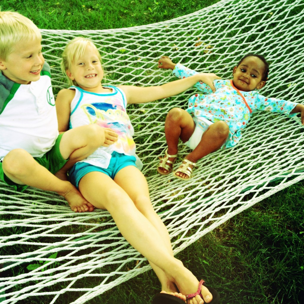 Swinging in hammocks with friends. Doesn't get much sweeter.