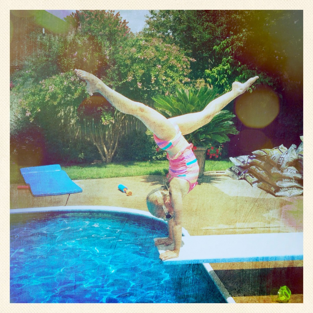 Tia is building up quite a cache of handstand pictures. I think I'm going to make her a mural for her wall.